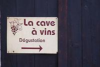 La cave a vin, the wine cellar, wine tasting. La Liquiere village. Faugeres. Languedoc. A door. France. Europe.