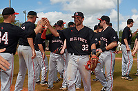 Ball State Cardinals third baseman William Baker (32) high fives teammates during a game against the Saint Joseph's Hawks on March 9, 2019 at North Charlotte Regional Park in Port Charlotte, Florida.  Ball State defeated Saint Joseph's 7-5.  (Mike Janes/Four Seam Images)