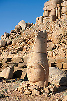 Statue head of Apollo in front of the stone pyramid 62 BC Royal Tomb of King Antiochus I Theos of Commagene, east Terrace, Mount Nemrut or Nemrud Dagi summit, near Adıyaman, Turkey