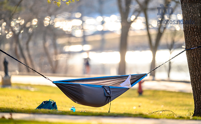 March 9, 2021; Student in a hammock on a nearly 70-degree March day. (Photo by Matt Cashore/University of Notre Dame)