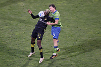 COLUMBUS, OH - DECEMBER 12: Gyasi Zardes #11 of the Columbus Crew and Gustav Svensson #4 of the Seattle Sounders FC challenge for a header during a game between Seattle Sounders FC and Columbus Crew at MAPFRE Stadium on December 12, 2020 in Columbus, Ohio.