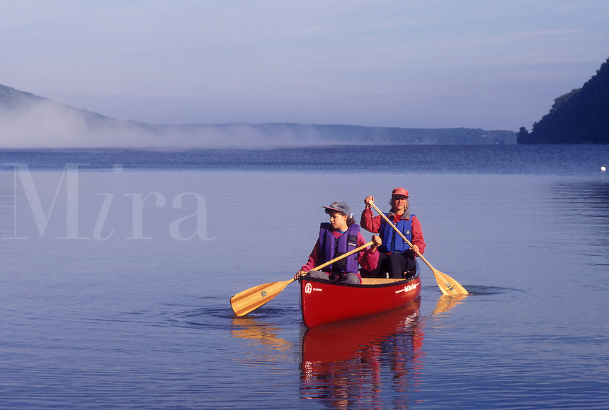 canoeing, canoe, Vermont, VT, Mother and daughter paddling a red canoe in the fog on Lake Willoughby in Westmore
