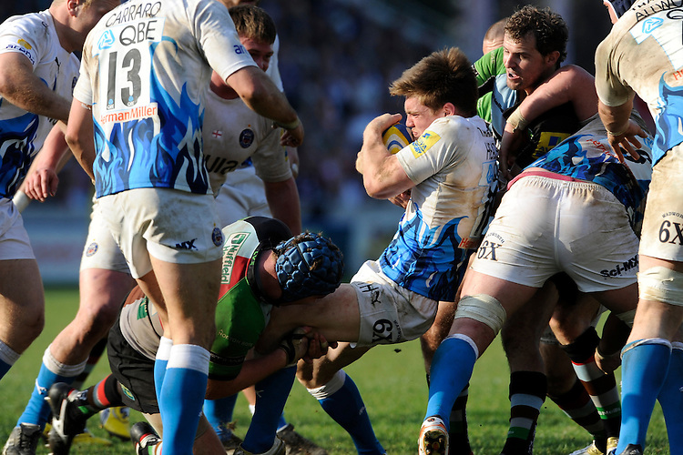 Tom Heathcote of Bath Rugby is wrapped up by Joe Gray of Harlequins during the Aviva Premiership match between Harlequins and Bath Rugby at The Twickenham Stoop on Saturday 24th March 2012 (Photo by Rob Munro)