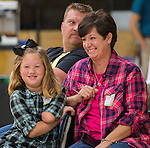 Gracie Henderson and her family react during a presentation of a prosthetic arm created with a 3D printer for the 6-year-old at Washington High School, November 2, 2015.