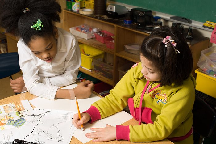 Education Elementary School grade 2 two girls working together on map project