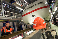 Am Freitag den 29. Januar 2016 wurde nach drei Jahren Umbauzeit eine neue Triebzughalle fuer ICE-Zuege auf dem Gelaende des Bahnbetriebswerk in Berlin-Rummelsburg eroeffnet.<br /> Die in den 1980er Jahren gebaute Wartungshalle wurde auf 380 Meter verlaengert und der komplette Hallenboden um einen Meter abgesenkt, um zwei 370 Meter lange Gleisbereiche einbauen zu koennenauf denen ICE-Zuege zeitgleich in vier unabhaengigen Arbeitsebenen instandgehalten werden. In Sachen Umweltschutz sorgen die neue Heizungs- und Beleuchtungsanlage sowie die neue Waermedaemmung fuer hohe Energieeinsparungen. Alle betriebswichtigen technischen Anlagen und Einrichtungen sind in den Betriebsfuehrungsrechner des Werks eingebunden. Damit ist es den Mitarbeiterinnen und Mitarbeitern der Leitstelle moeglich, jederzeit alle wichtigen Informationen zum Zug und zu den aktuellen Arbeiten im Blick zu haben. Die Gesamtkosten der neuen Anlage belaufen sich auf rund 40 Millionen Euro. Die Halle wird soll im Maerz 2016 nach der Betriebserprobung und dem Abschluss aller Bauarbeiten in Betrieb gehen.<br /> Im Bild: Ein aufgestaenderter ICE-2.<br /> 27.1.2016, Berlin<br /> Copyright: Christian-Ditsch.de<br /> [Inhaltsveraendernde Manipulation des Fotos nur nach ausdruecklicher Genehmigung des Fotografen. Vereinbarungen ueber Abtretung von Persoenlichkeitsrechten/Model Release der abgebildeten Person/Personen liegen nicht vor. NO MODEL RELEASE! Nur fuer Redaktionelle Zwecke. Don't publish without copyright Christian-Ditsch.de, Veroeffentlichung nur mit Fotografennennung, sowie gegen Honorar, MwSt. und Beleg. Konto: I N G - D i B a, IBAN DE58500105175400192269, BIC INGDDEFFXXX, Kontakt: post@christian-ditsch.de<br /> Bei der Bearbeitung der Dateiinformationen darf die Urheberkennzeichnung in den EXIF- und  IPTC-Daten nicht entfernt werden, diese sind in digitalen Medien nach §95c UrhG rechtlich geschuetzt. Der Urhebervermerk wird gemaess §13 UrhG verlangt.]