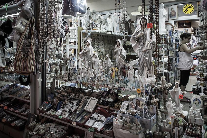 Souvenir shops stay open during the all-night prayer vigil before the apparition of 02 July.<br /> Bijakovici, Medjugorje, Bosnia and Herzegovina. 01 July 2012