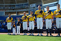 Erik Bakich (23), Nick Schnabel (23), John Dilaura (50), Chris Fetter (41), and Jesse Franklin (7) of the Michigan Wolverines stand for the national anthem before a game against Army West Point on February 17, 2018 at Tradition Field in St. Lucie, Florida.  Army defeated Michigan 4-3.  (Mike Janes/Four Seam Images)