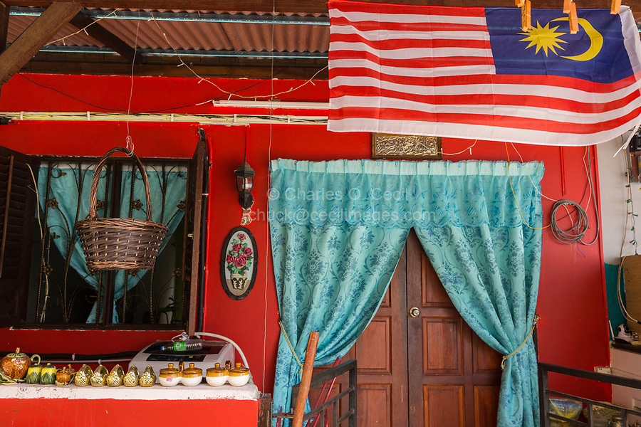 Malaysian Flag above Entrance to a Traditional Malaysian House in the Heritage Area, Melaka, Malaysia.