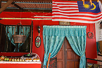 Malaysian Flag above Entrance to a Traditional Malaysian House in the Heritage Area, Melaka, Malaysia.