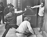 1971 File<br /> <br /> Battling on campus of University of Toronto outside a rally where Quebec union leader Michel Chartrand and Montreal lawyer Robert Lemieux were speaking; a youth claiming to be a member of rightwing Edmund Burke Society aims a spray into the face of student<br /> <br /> 1971<br /> <br /> PHOTO :  Bob Olsen - Toronto Star Archives - AQP