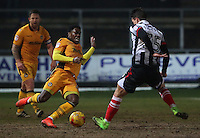 Mitchell Rose of Newport County tackles Sam Jones of Grimsby Town during the Sky Bet League Two match between Newport County and Grimsby Town at Rodney Parade, Newport, Wales, UK. Tuesday 14 February 2017