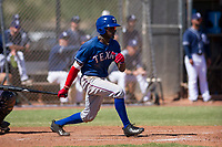 Texas Rangers outfielder Eric Jenkins (92) starts down the first base line during an Instructional League game against the San Diego Padres on September 20, 2017 at Peoria Sports Complex in Peoria, Arizona. (Zachary Lucy/Four Seam Images)