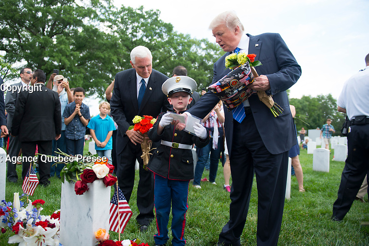 President Donald J. Trump and Vice President Mike Pence talk with Christian Jacobs, 6, at the grave of his father in Section 60 of Arlington National Cemetery, Arlington, Va., May 29, 2017.  Christian visits with his mother, Brittany, every year for Memorial Day.  (U.S. Army photo by Elizabeth Fraser/Arlington National Cemetery/released)