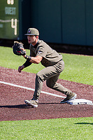 Vanderbilt Commodores first baseman Dominic Keegan (12) handles his position against the South Carolina Gamecocks at Hawkins Field in Nashville, Tennessee, on March 21, 2021. The Gamecocks won 6-5. (Danny Parker/Four Seam Images)