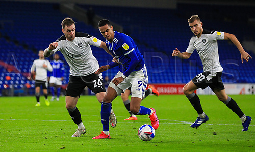 3rd November 2020; Cardiff City Stadium, Cardiff, Glamorgan, Wales; English Football League Championship Football, Cardiff City versus Barnsley; Michael Sollbauer of Barnsley jostles for possession with Robert Glatzel of Cardiff City
