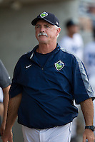 Hillsboro Hops pitching coach Doug Drabek (15) during a game against the Tri-City Dust Devils at Ron Tonkin Field in Hillsboro, Oregon on August 24, 2015.  Tri-City defeated Hillsboro 5-1. (Ronnie Allen/Four Seam Images)