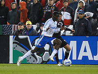 Kansas City Wizards forward Eddie Johnson (7) fights to keep possession of the ball while defended by DC United midfielder Ben Olsen (14). The Kansas City Wizards defeated DC United 4-2, in the home opening game for DC United at RFK Stadium, April 14, 2007.