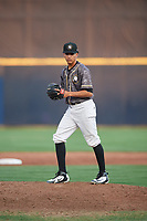 Quad Cities River Bandits relief pitcher Willy Collado (28) gets ready to deliver a pitch during a game against the West Michigan Whitecaps on July 22, 2018 at Modern Woodmen Park in Davenport, Iowa.  West Michigan defeated Quad Cities 6-4.  (Mike Janes/Four Seam Images)