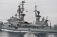 - a US Navy Seahawk helicopter flies over the German frigate Luetjens  during NATO exercises in the Mediterranean sea ....- un elicottero Seahawk dell'US Navy sorvola la fregata tedesca Luetjens durante esercitazioni NATO nel mar Mediterraneo