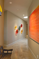hallway with glass art and painting on wall