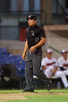 Home plate umpire Shin Koishizawa during a Pioneer League game between the Great Falls Voyagers and Missoula Osprey at Centene Stadium at Legion Park on August 19, 2019 in Great Falls, Montana. Missoula defeated Great Falls 1-0 in the second game of a doubleheader. (Zachary Lucy/Four Seam Images)