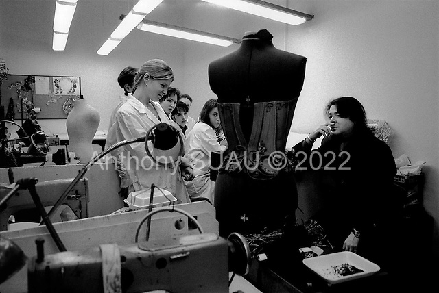 Moscow, Russia  .1998.Fashion designer Valentin Yudashikin speaks with a few of his employees in his large production and fashion house on Moscow's Kutuzovki Prospect. Valentin is one of Russias' most successful designers..
