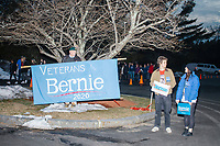 """Army Special Forces veteran John W. Jones, of Sutton, New Hampshire, holds a sign reading """"Veterans for Bernie 2020"""" before a campaign rally for Democratic presidential candidate and Vermont senator Bernie Sanders at Hampshire Hills Athletic Club in Milford, New Hampshire, on Tue., Feb. 4, 2020. The  event started around 7pm and was the first event Sanders held after the previous day's Iowa Caucuses. The results of the caucuses were unknown until the Democratic party released partial numbers at 5pm, showing Sanders and former South Bend, Ind., mayor Pete Buttigieg both as frontrunners. Jones said the sign said 2016 before, but he updated it for this campaign cycle. """"I hope that brighter days are coming for all of us,"""" Jones said."""