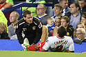Physio Paul Dando treats Darius Charles of Stevenage<br />  - Everton v Stevenage - Capital One Cup Second Round - Goodison Park, Liverpool - 28th August, 2013<br />  © Kevin Coleman 2013