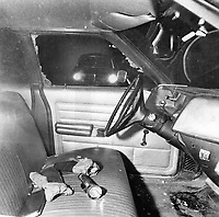 1973 File - In the cruiser driven by Constable James Lothian; his gloves; flashlight and book of traffic tickets lie on the front seat after he was shot. Police do not know when or how the front window on the driver's side of the car was shattered.<br /> <br /> Photo : Bob Olsen<br /> Toronto Star Archives via AQP