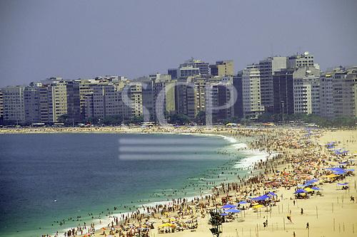 Rio de Janeiro, Brazil.  Copacabana beach with lots of people bathing.