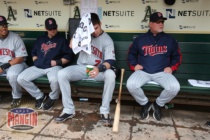 OAKLAND, CA - JUNE 11:  Joe Mauer (left) and manager Ron Gardenhire of the Minnesota Twins get ready in the dugout before the game against the Oakland Athletics at the Oakland Coliseum in Oakland, California on Thursday, June 11, 2009.  The Athletics defeated the Twins 4-3.  Photo by Brad Mangin