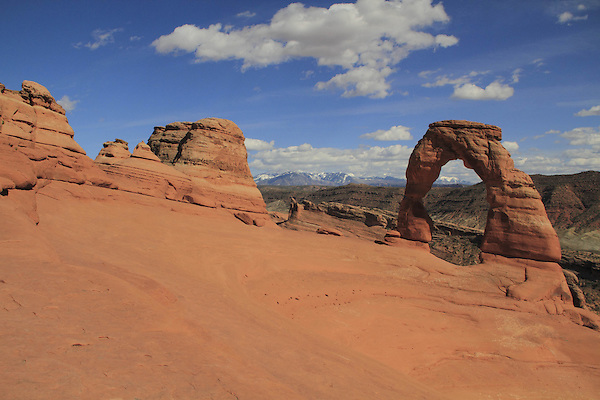 Delicate Arch and the La Sal Mountains in Arches National Park, Moab, Utah, USA. .  John offers private photo tours in Arches National Park and throughout Utah and Colorado. Year-round.