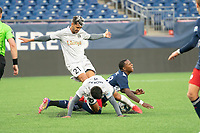 FOXBOROUGH, MA - APRIL 17: Michel #48 of New England Revolution II and Zaca Moran #6 of Richmond Kickers tangle in a tackle in the midfield during a game between Richmond Kickers and Revolution II at Gillette Stadium on April 17, 2021 in Foxborough, Massachusetts.