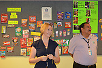 As part of the H.E.A.R.T. partnership with HISD, 17 high school students with disabilities are working and learning on the job at the Houston Food Bank. Stantial and Dr. Castillo in front of the product recognition wall in the classroom.