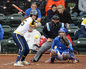 Michigan Wolverines outfielder Nicole Sappingfield (15) at bat in front of catcher Aubree Munro (1) and umpire Tyrone Miller during the teams season opener against the Florida Gators on February 8, 2014 at the USF Softball Stadium in Tampa, Florida.  Florida defeated Michigan 9-4 in extra innings.  (Mike Janes/Four Seam Images via AP Images)
