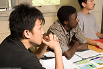 Education High School public male students listening in mathematics class horizontal