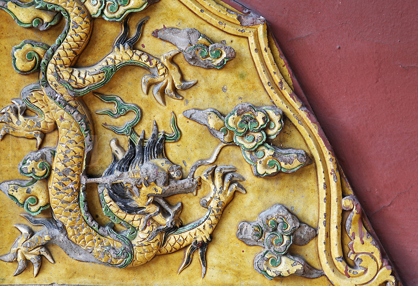 Architectural detail of a yellow enameled dragon on a temple in the Yonghe Lamasery, Beijing, China, Asia