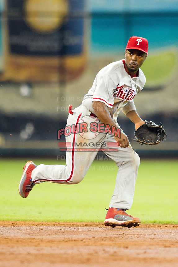 Philadelphia Phillies shortstop Jimmy Rollins #11 on defense during the Major League baseball game against the Houston Astros on September 16th, 2012 at Minute Maid Park in Houston, Texas. The Astros defeated the Phillies 7-6. (Andrew Woolley/Four Seam Images)..