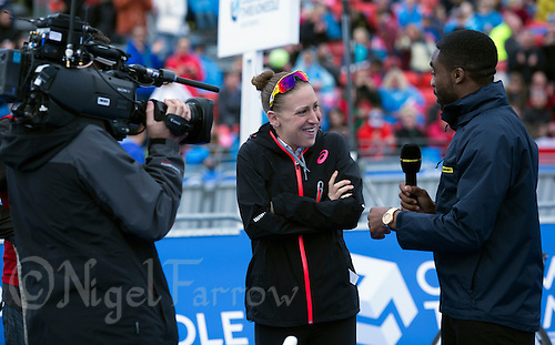31 MAY 2015 - LONDON, GBR - Great Britain triathlete Jodie Stimpson (GBR) is interviewed for a BBC television report by Ore Oduba before the start of the elite women's 2015 ITU World Triathlon Series round at Hyde Park in London, Great Britain (PHOTO COPYRIGHT © 2015 NIGEL FARROW, ALL RIGHTS RESERVED)