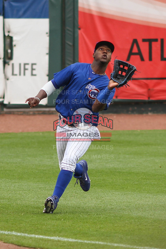 Iowa Cubs outfielder Junior Lake (21) catches a fly ball during a Pacific Coast League game against the Colorado Springs Sky Sox on May 10th, 2015 at Principal Park in Des Moines, Iowa.  Iowa defeated Colorado Springs 14-2.  (Brad Krause/Four Seam Images)