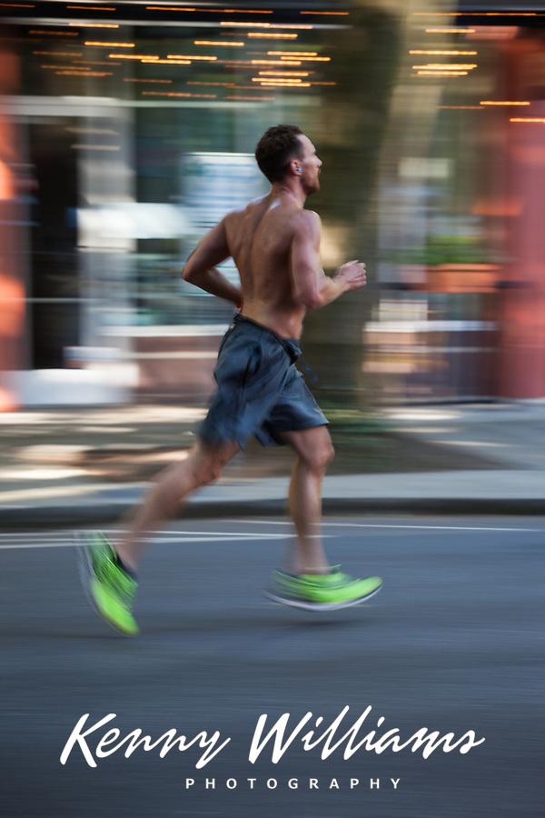 Man Running in Komen Race for The Cancer Cure, Seattle, WA, USA.