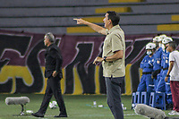 IBAGUE - COLOMBIA, 30-03-2021: Alexandre Guimaraes técnico de Nacional gesticula durante partido entre Deportes Tolima y Atlético Nacional por la fecha 16 como parte de la Liga BetPlay DIMAYOR I 2021 jugado en el estadio Manuel Murillo Toro de la ciudad de Ibagué. / Alexandre Guimaraes coach of Nacional gestures during match between Deportes Tolima and Atletico Nacional for the date 16 as part of BetPlay DIMAYOR League I 2021 played at Manuel Murillo Toro stadium in Ibague. Photo: VizzorImage / Juan Torres / Cont