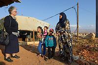 LEBANON Deir el Ahmad, a maronite christian village in Beqaa valley, syrian refugee camp / LIBANON Deir el Ahmad, ein christlich maronitisches Dorf in der Bekaa Ebene, Good Shepherds Sisters der maronitischen Kirche, Schwester Amira Tabet im Camp fuer syrische Fluechtlinge, mit Soumaya Alkhatib, die Mutter des Jungen Ahmad