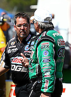 Mar 14, 2014; Gainesville, FL, USA; NHRA funny car driver John Force (right) talks with Dean Antonelli during qualifying for the Gatornationals at Gainesville Raceway Mandatory Credit: Mark J. Rebilas-USA TODAY Sports