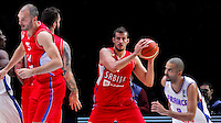 Serbia's Nemanja Bjelica (C) controls the ball during European championship basketball match for third place between France and Serbia on September 20, 2015 in Lille, France  (credit image & photo: Pedja Milosavljevic / STARSPORT)