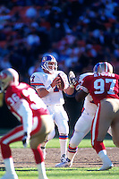 SAN FRANCISCO, CA - Quarterback John Elway of the Denver Broncos in action during a game against the San Francisco 49ers at Candlestick Park in San Francisco, California in 1994. Photo by Brad Mangin