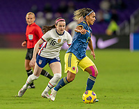 ORLANDO, FL - JANUARY 18: Rose Lavelle #16 of the USWNT defends Jessica Caro #8 of Colombia during a game between Colombia and USWNT at Exploria Stadium on January 18, 2021 in Orlando, Florida.