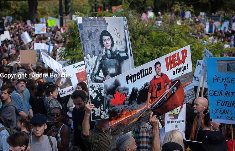 Plus de 500 000 personnes participent a la marche pour le climat, en presence de Greta Thunberg, vendredi 27 septembre 2019, dans les rues de Montreal.<br /> <br /> PHOTO : Agence Quebec Presse - Andre Boucher