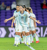 ORLANDO, FL - FEBRUARY 21: Mariana Larroquette #19 of Argentina yells to a teammate during a game between Canada and Argentina at Exploria Stadium on February 21, 2021 in Orlando, Florida.